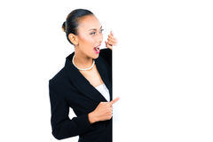 Asian businesswoman showing empty white board Stock Photo