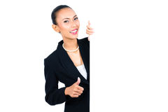 Asian businesswoman showing empty white board Royalty Free Stock Photo