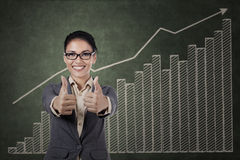 Asian businesswoman showing two thumbs up Stock Image