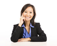 Asian businesswoman sitting at desk Royalty Free Stock Photo