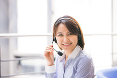 Asian Businesswoman sitting at her desk in an office Royalty Free Stock Image