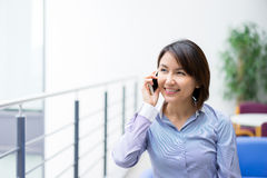 Asian Businesswoman sitting at her desk in an office Royalty Free Stock Images