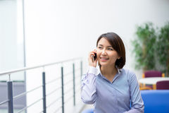 Asian Businesswoman sitting at her desk in an office Stock Photos