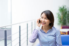 Asian Businesswoman sitting at her desk in an office Stock Images