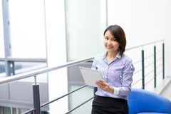 Asian Businesswoman sitting at her desk in an office Royalty Free Stock Photography