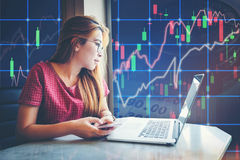 Asian businesswoman sitting and working Laptop Stock market exch. Asian businesswoman sitting  working Laptop Stock market exchange information and Trading graph Stock Images