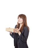 Asian Businesswoman smile  look up over a box Royalty Free Stock Photos