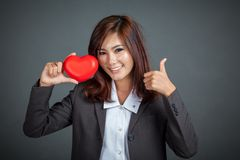 Asian businesswoman smile thumbs up with red heart Royalty Free Stock Images