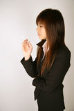 Asian businesswoman smoking Stock Photo
