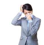 Asian businesswoman sneeze and headache Royalty Free Stock Image