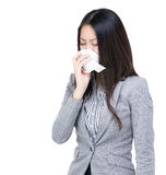 Asian businesswoman sneeze. Isolated on white Royalty Free Stock Photo