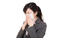 Asian businesswoman sneeze. Isolated on white Stock Image