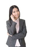 Asian businesswoman speaking on the cell phone. Young asian businesswoman speaking on the cell phone. A portrait isolated on the white background Stock Photo
