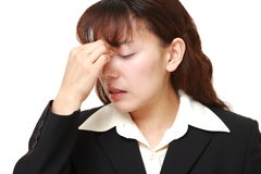 Asian businesswoman suffers from Asthenopia Stock Images