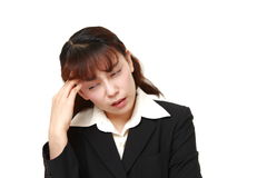 Asian businesswoman suffers from headache Royalty Free Stock Photos