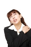 Asian businesswoman suffers from neck ache Royalty Free Stock Image