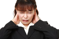 Asian businesswoman suffers from neck ache Stock Photo