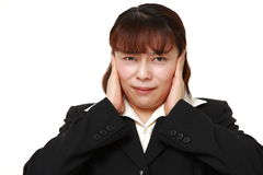 Asian businesswoman suffers from noise Stock Photography