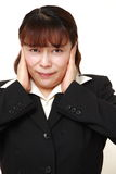 Asian businesswoman suffers from noise Royalty Free Stock Photo