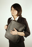 Asian businesswoman with suitcase Stock Images