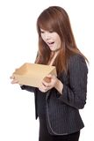 Asian Businesswoman surprise look inside a box Royalty Free Stock Photos