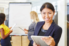 Asian businesswoman with tablet computer Royalty Free Stock Photos