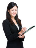 Asian businesswoman take note on clipboard Royalty Free Stock Photo