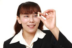 Asian businesswoman takes a supplement Stock Photos