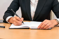 Asian businesswoman taking notes and planning. In a meeting Royalty Free Stock Photography