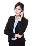 Asian businesswoman talk to cellphone Stock Photo