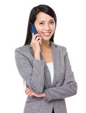 Asian businesswoman talk to cellphone Royalty Free Stock Image