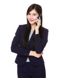 Asian businesswoman talk to mobile phone Royalty Free Stock Photo