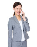 Asian businesswoman talk to mobile phone Royalty Free Stock Photography