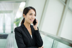 Asian Businesswoman talk to mobile phone at office Stock Images