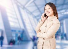Asian businesswoman talking on mobile phone Stock Photo
