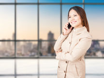 Asian businesswoman talking on mobile phone Stock Photography
