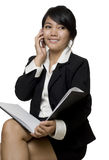 Asian businesswoman talking on the telephone Royalty Free Stock Photos