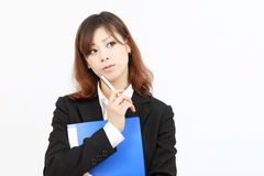 Asian businesswoman is thinking. Young japanese businesswoman is thinking Stock Photos
