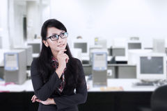 Asian businesswoman thinking at office Stock Images