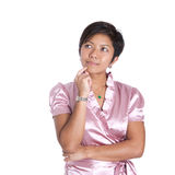 Asian businesswoman in a thinking pose Royalty Free Stock Photos
