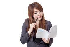 Asian businesswoman is  thinking read a book Stock Image