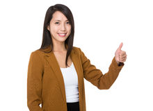 Asian businesswoman with thumb up Stock Photo