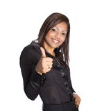 Asian businesswoman with thumbs up. Young Asian businesswoman with thumbs up gesture showing positivity royalty free stock photos