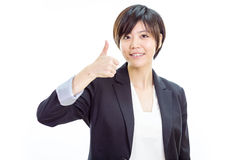 Asian businesswoman with thumbs up royalty free stock photo