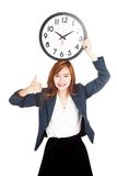 Asian businesswoman thumbs up with clock over head Royalty Free Stock Images