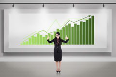 Asian businesswoman thumbs up on growing bar chart billboard Stock Photos