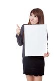 Asian businesswoman  thumbs-up with a vertical  blank sign Royalty Free Stock Photo