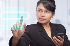 Asian businesswoman with touch screen Royalty Free Stock Photography
