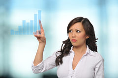 Asian Businesswoman with touch screen royalty free stock image