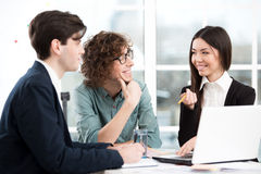 Asian businesswoman and two businessmen working Royalty Free Stock Photography